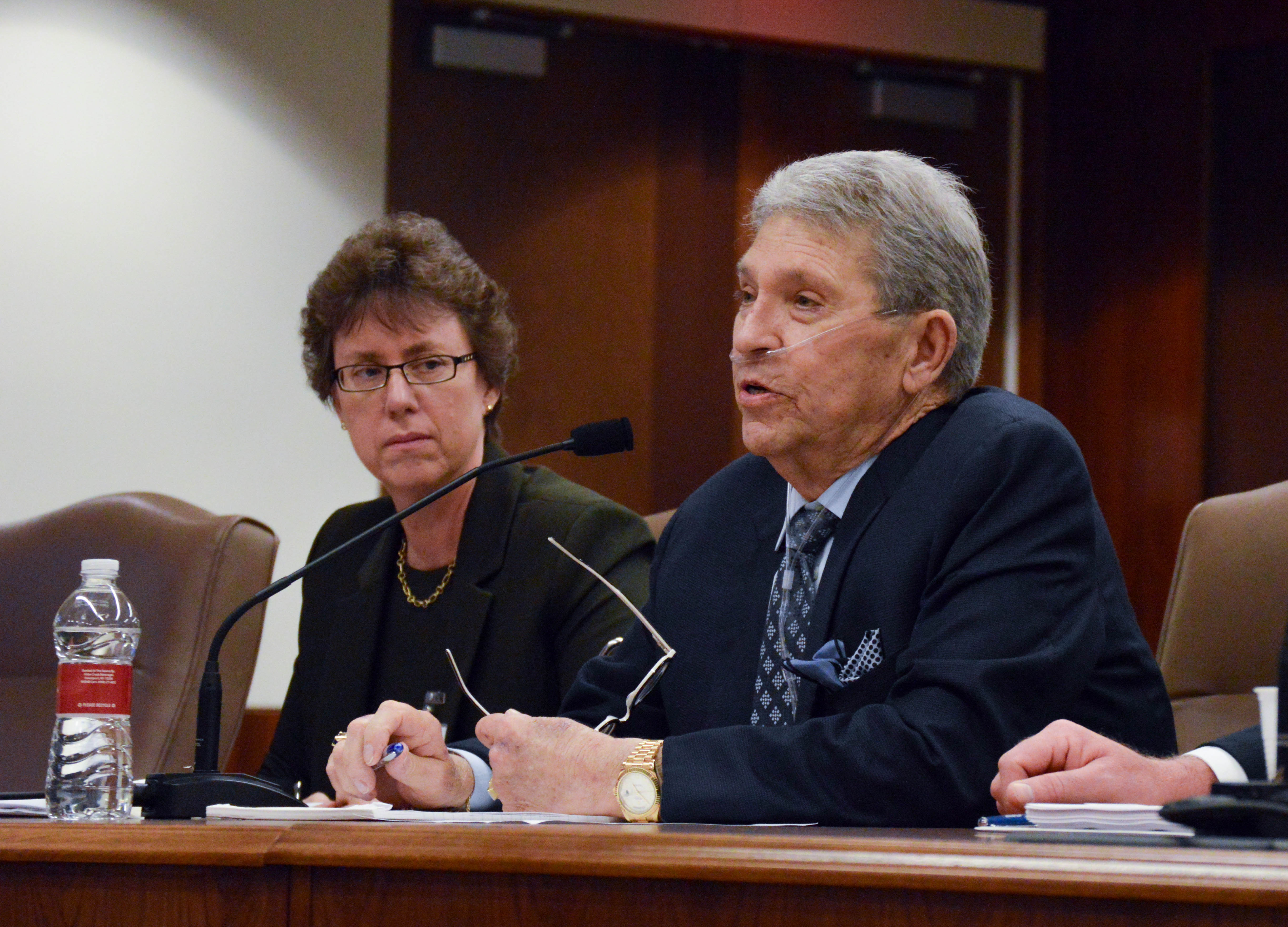 Cindy Sanborn (left) and the late Hunter Harrison (right) representing CSX at a Surface Transportation Board meeting.